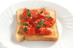 Toast with cut tomato Royalty Free Stock Images