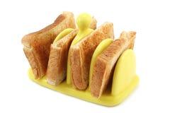 Toast in der gelben keramischen Toast-Zahnstange Lizenzfreie Stockfotos