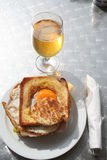 Toast with egg, bacon,ham and so on. Delicious toast with egg,bacon,ham,tomato and lettuce, which is served together with a glass of cold beer Stock Photos