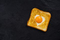 Toast with egg for Valentines day Stock Photos