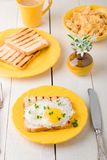 Toast with egg in yellow plate with Micro-greenery Stock Photo