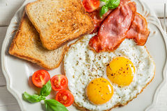 Toast, eggs and bacon for breakfast Royalty Free Stock Photography