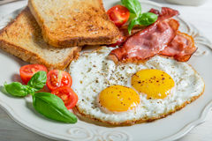 Toast, eggs and bacon for breakfast Royalty Free Stock Photo