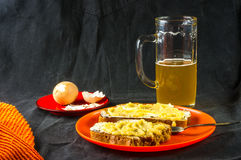 Toast, eggs and beer. The bachelor dinner - toast with butter and yellow caviar, boiled eggs and unfiltered beer Royalty Free Stock Photo