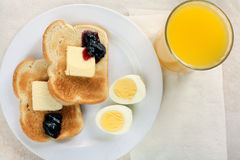 Toast,eggs & juice breakfast. A simple breakfast. Hard boiled eggs,toast & jelly. Orange juice Royalty Free Stock Image