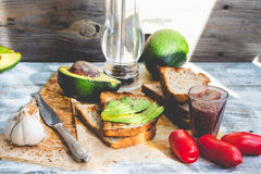 Toast with fresh avocado and pepper, healthy snack, vegetarian f Stock Photos
