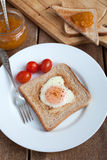 Toast with fried egg in the shape of heart and cherry tomatoes Royalty Free Stock Photo