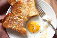 Toast with fried egg Stock Photos