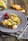 Toast with fried quail eggs and avocado Royalty Free Stock Photo