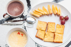 Toast with fruit and chocolate milk Stock Images