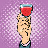 Toast glass red wine pop art. Retro vector. The triumph holiday party Stock Images