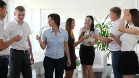Toast in glasses with champagne into hands of office people in boardroom stock video footage