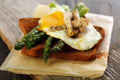 Toast with green asparagus and egg. Stock Images