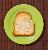 Toast on green plate. Stock Photos