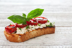 Toast with grilled tomatoes and soft cheese Stock Photo