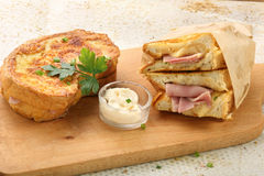 Toast with ham and cheese on a chopping board Stock Photography