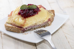 Toast Hawaii topped with cranberries Stock Photos