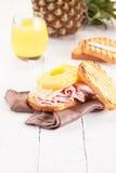 Toast Hawaii on wooden table Stock Image