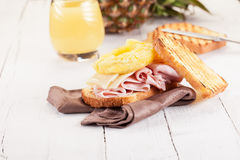 Toast Hawaii on wooden table Royalty Free Stock Image