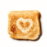 Toast with a heart on it Royalty Free Stock Image