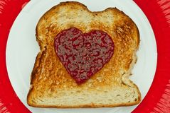Toast with Heart Made of Jam Stock Images