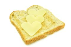 Toast with heart shaped cheese slices Royalty Free Stock Images