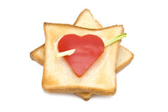 Toast with heart-shaped Paprika. Isolated on white Stock Photos