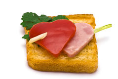 Toast with Heart-shaped Paprika and Ham. Isolated on white Royalty Free Stock Image
