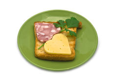 Toast with heart-shaped Sausage and Cheese on Green Plate Royalty Free Stock Photography