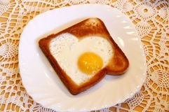 Toast with a hearty-like fried egg royalty free stock image