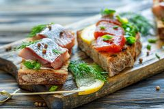 Toast with herring, caviar, green onion and dill. Royalty Free Stock Photos