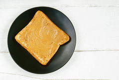 Toast with homemade peanut butter on a white table. Top view. Selective focus Royalty Free Stock Photo