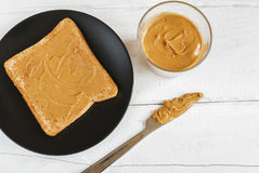 Toast with homemade peanut butter on a white table. Top view. Selective focus Royalty Free Stock Image