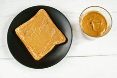 Toast with homemade peanut butter on a white table. Top view. Selective focus Royalty Free Stock Photos