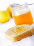 Toast with honey Stock Photos