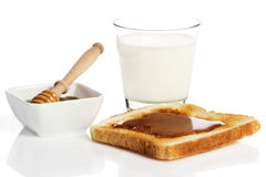 Toast with honey and milk Stock Images
