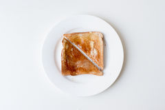 Toast with honey on white plate Royalty Free Stock Photography
