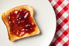Toast with jam. On picnic tablecloth Stock Images