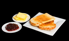 Toast and Jam on black background. Toast served with jam and butter isolated over black background Royalty Free Stock Photography