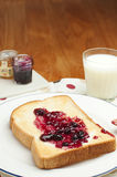 Toast and jam for breakfast. Toast with jam and milk for breakfast Stock Images
