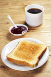 Toast with jam and coffee cup Royalty Free Stock Photo