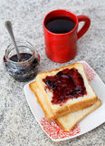 Toast with jam and a cup Royalty Free Stock Photos