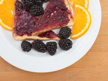 Toast with jam garnished with fruit Royalty Free Stock Images