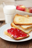 Toast with jam and milk Stock Images