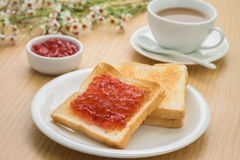 Toast with jam on plate and coffee cup, Royalty Free Stock Photography