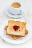 Toast with jam in the shape of a heart and coffee, vertical Royalty Free Stock Photos