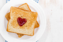 Toast with jam in the shape of a heart for Valentine's Day Royalty Free Stock Images