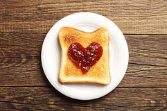 Toast with jam in shape of hearts Royalty Free Stock Images