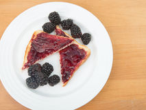 Toast with jam and a side of blackberries Royalty Free Stock Photo