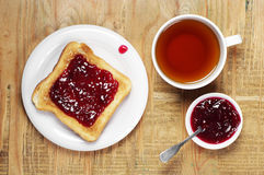 Toast with jam and tea Stock Image